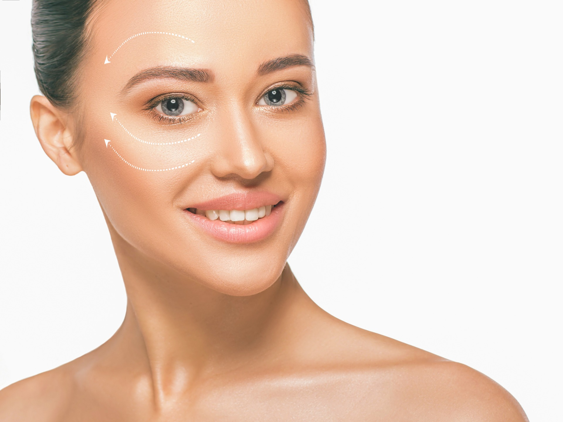 portrait of beautiful woman with perfect skin face, with massage lines on face, skin care concept. Caring for the skin around the eyes