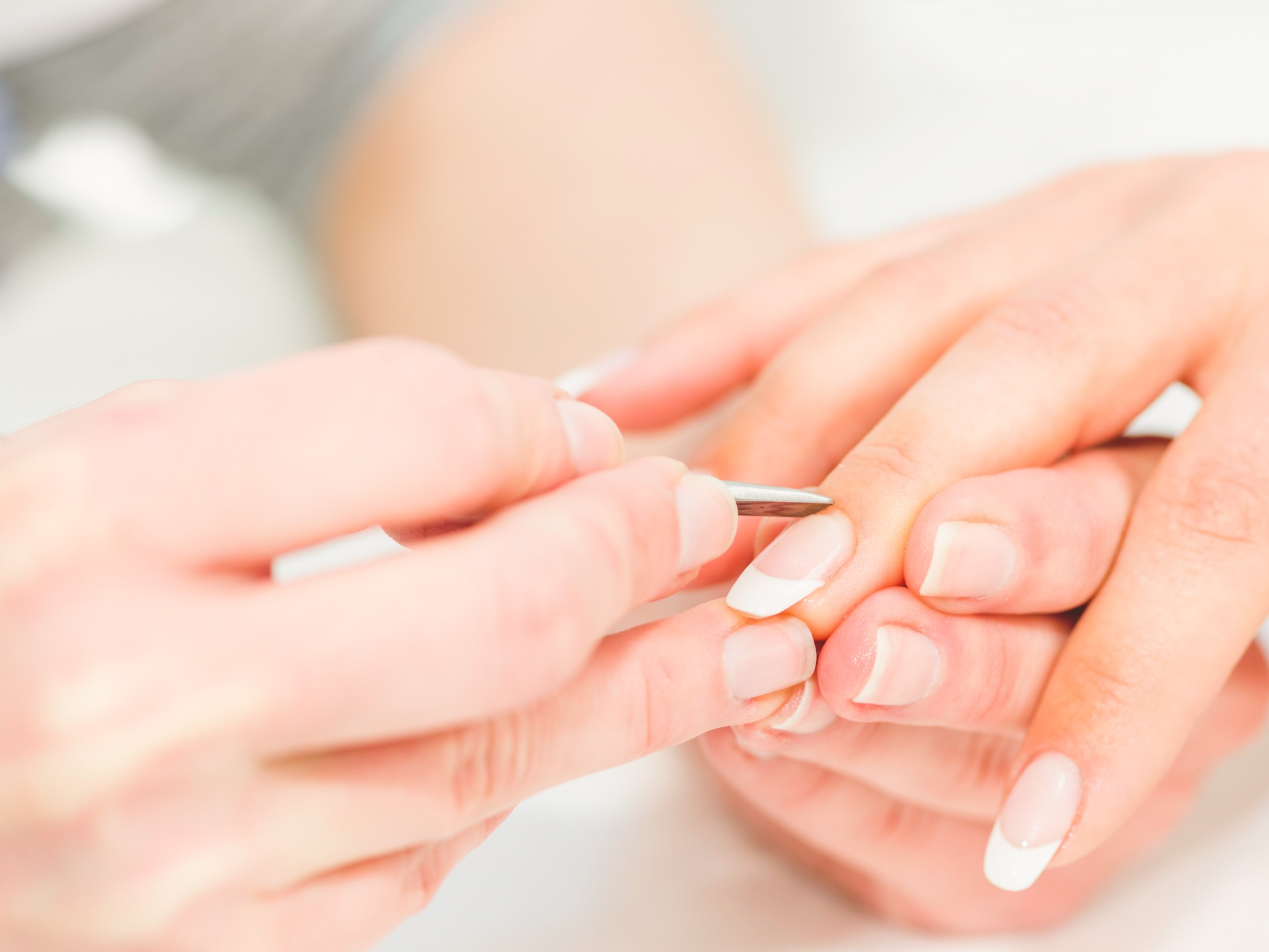 manicuring hands - pushing cuticles
